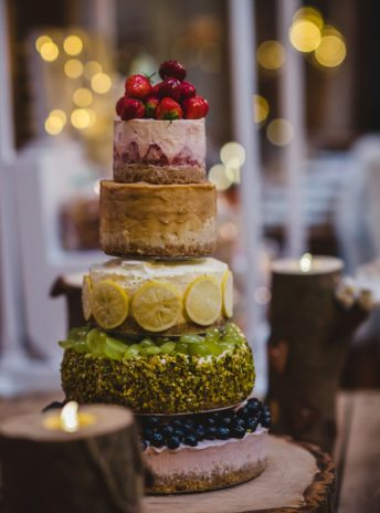 five layer cheese cake with different fruit on each layer