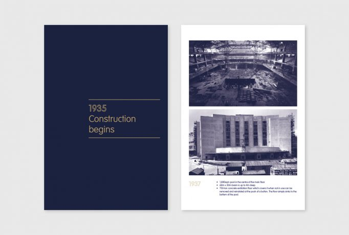 '1935 Construction begins' written in grey on a dark blue exhibition panels, next to some photographs of de construction of the Earls Court