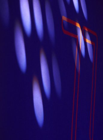 dark blue background with the number 77 in orange and some light spots