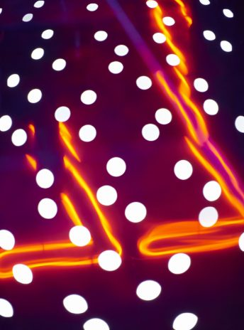 orange neon lights and white dots