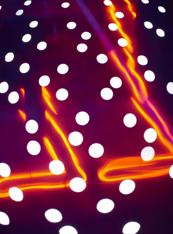 orange neon lights and white dots