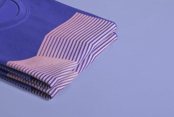 close up on blue folded shirts with illustration