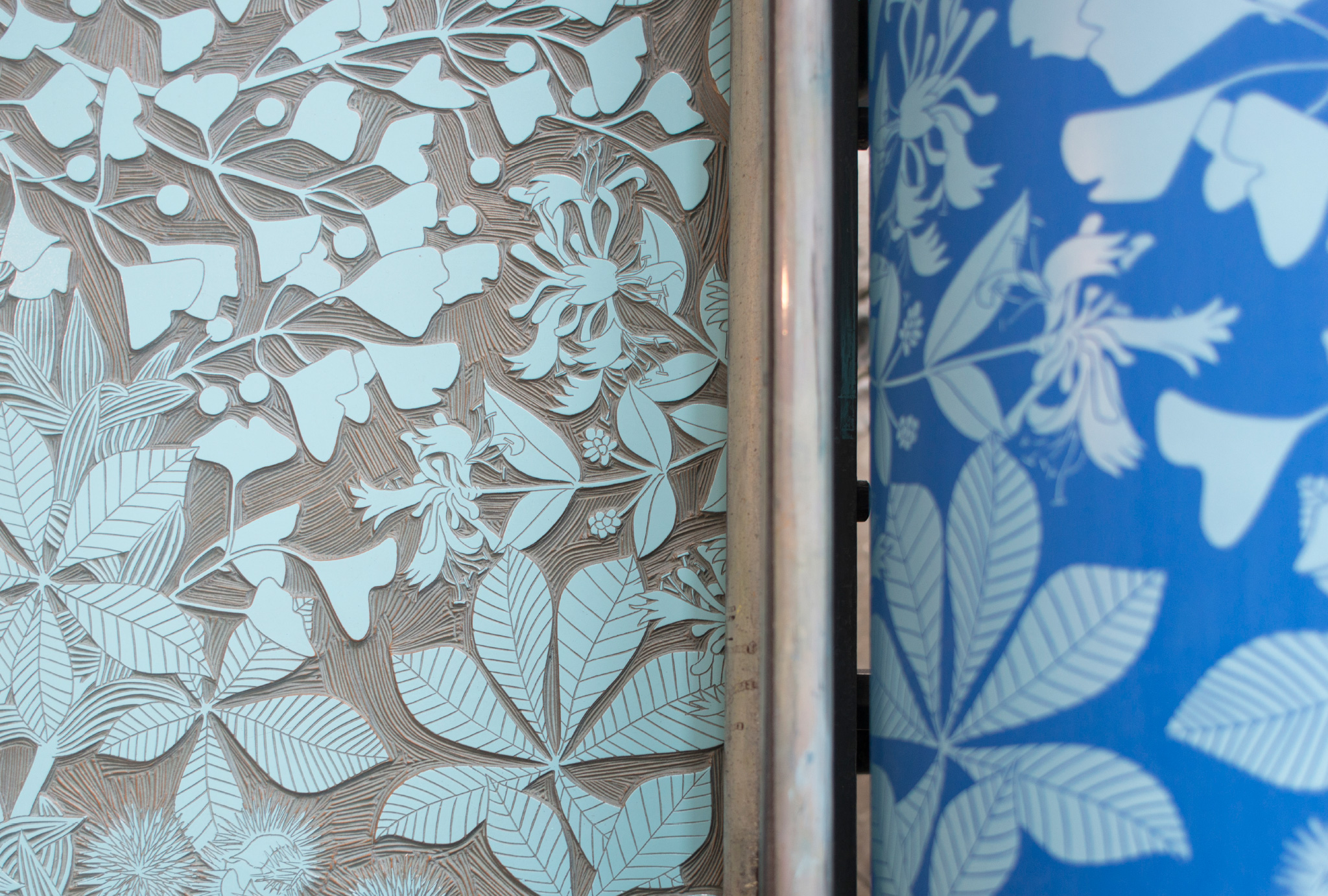 close up at a lino roll with the cutted out design and the printed design