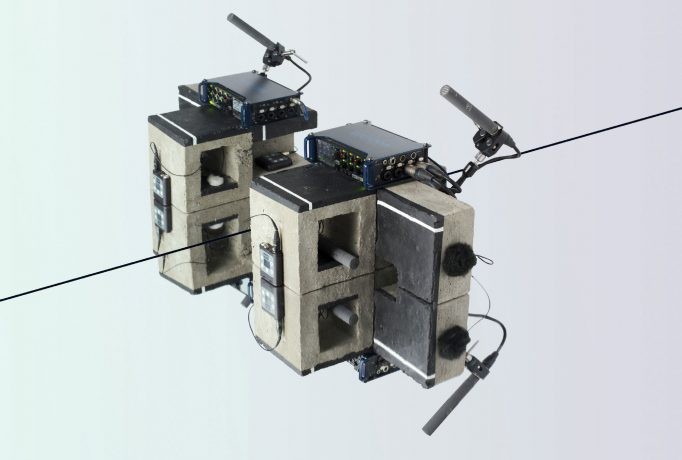 sound recording equipment on concrete blocks against a mirrored background