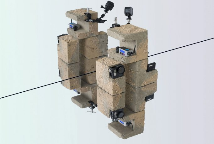 camera positioned on concrete blocks with sand texture