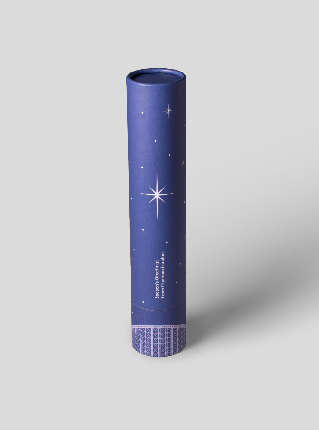 blue Christmas card rolled with silver stars