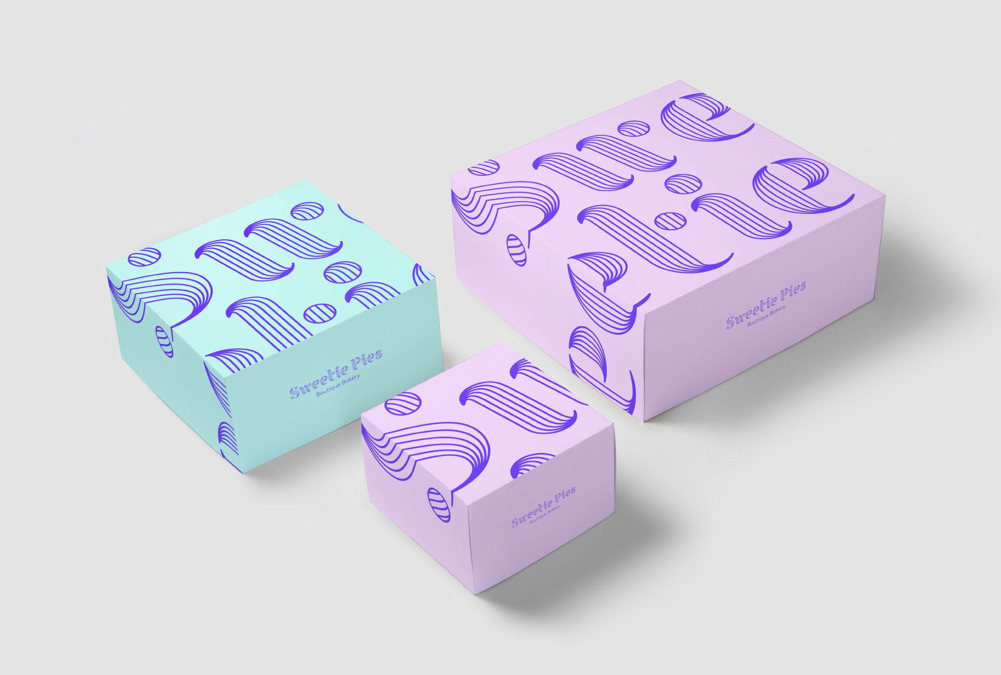 three boxes next to each other in lilac and turquoise