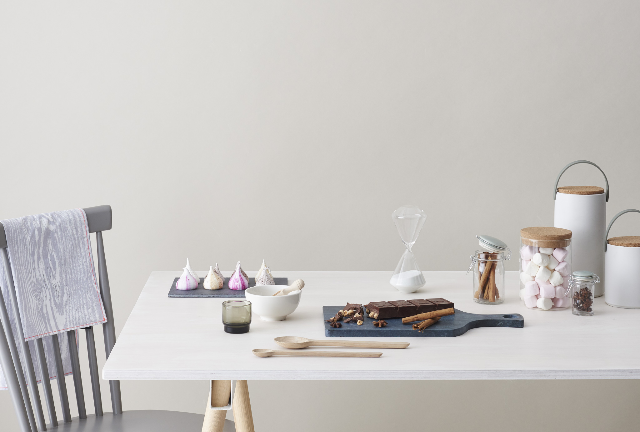 chair and table with different sweets on it, viewed from the side