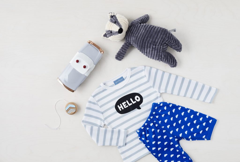grey and white stripped pyjama, racoon teddy and toys