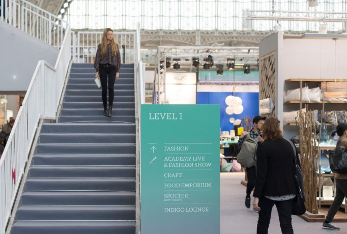 stairs in the exhibition with directional signs