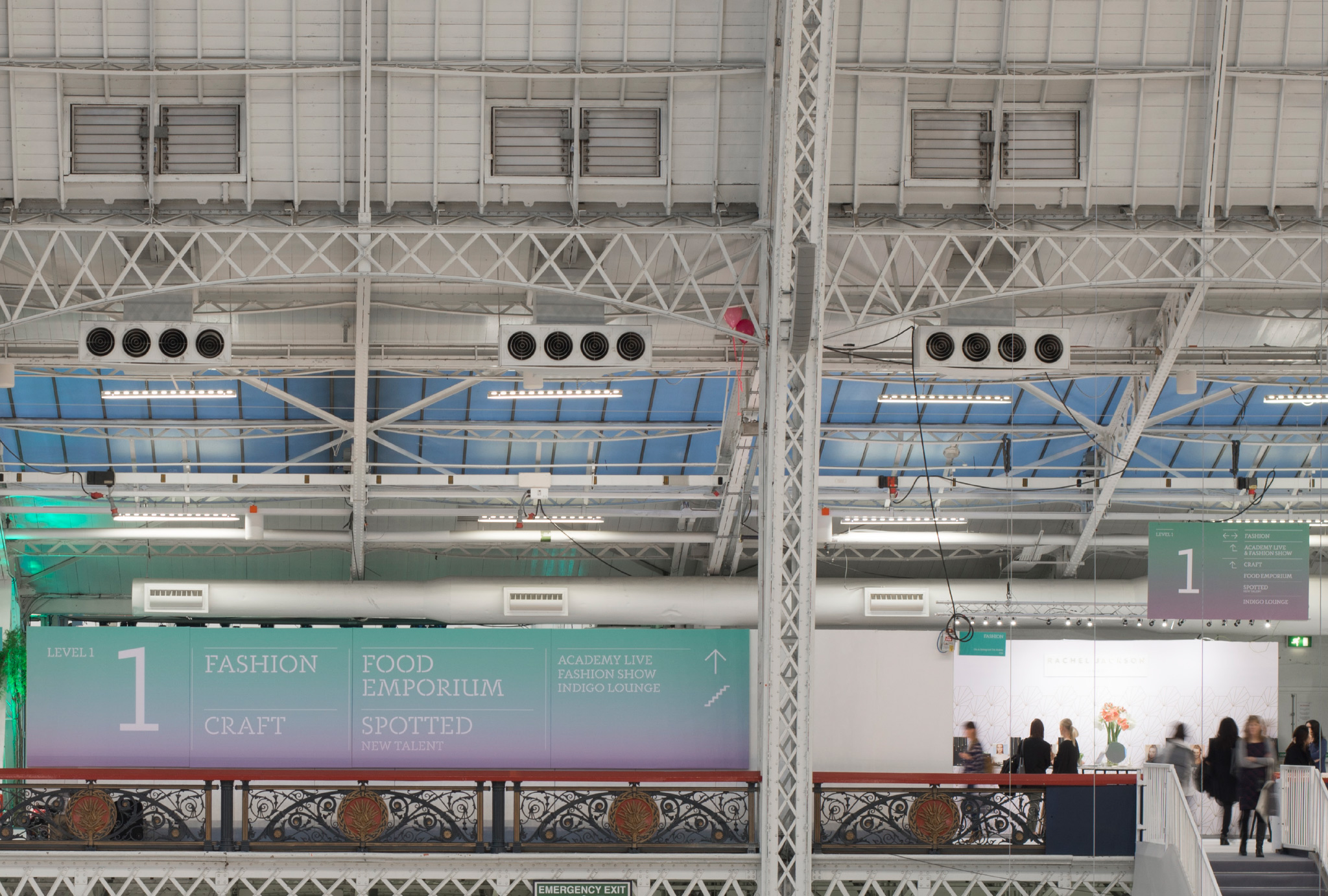 directional signs at the top of the stairs in Olympia London