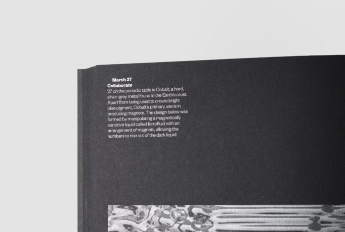 close up of a silver written text of 'March 27, Collaborate' in a black book