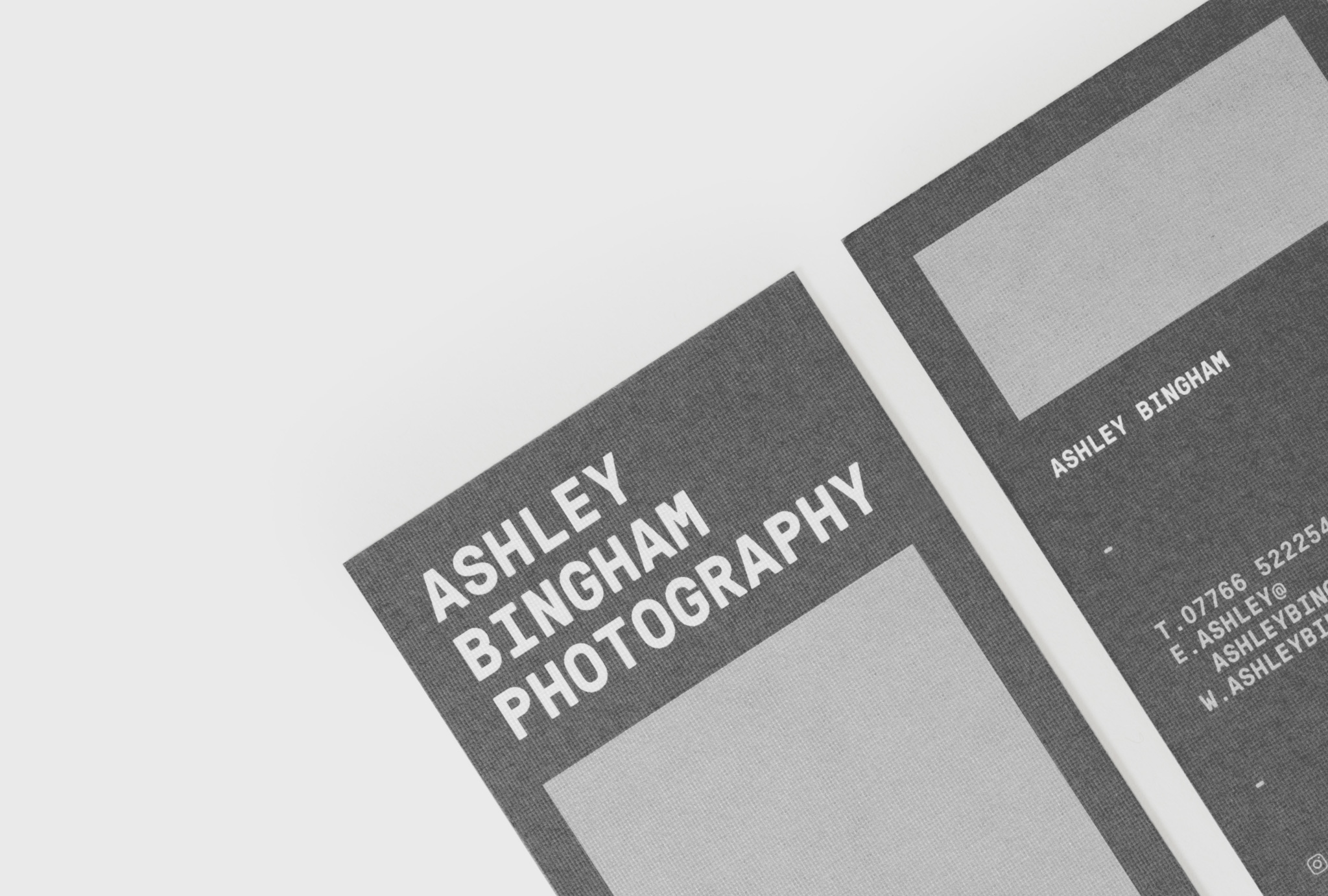 close up at dark grey stationery with light grey boxes and written 'ASHLEY BINGHAM PHOTOGRAPHY'