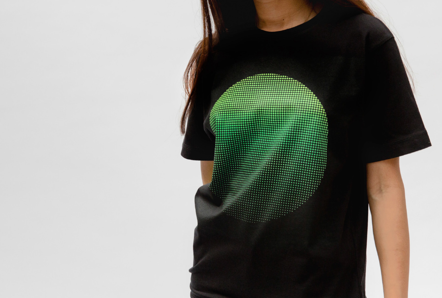 woman wearing black t-shirt with printed green circle