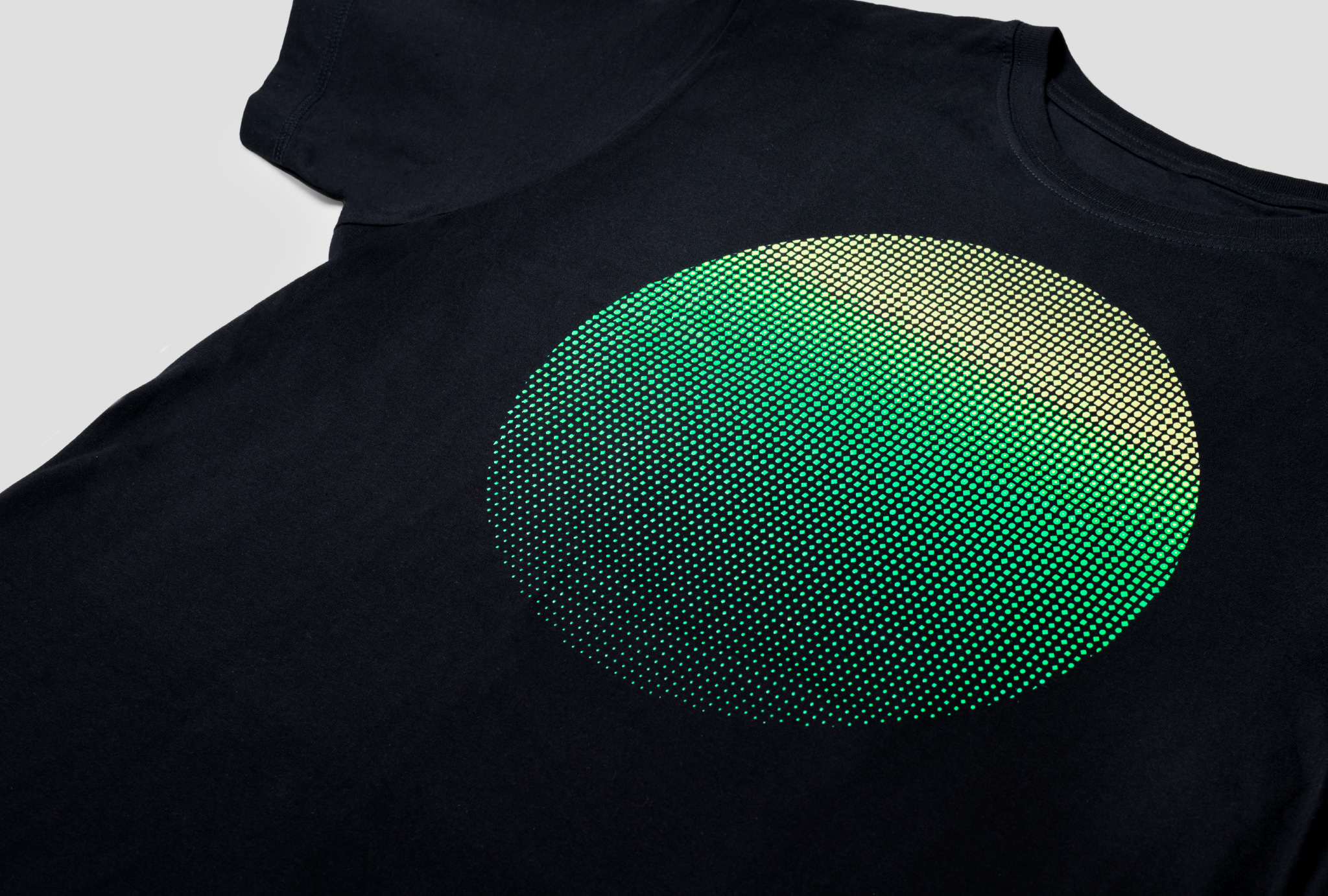 close up on black t-shirt with printed green circle