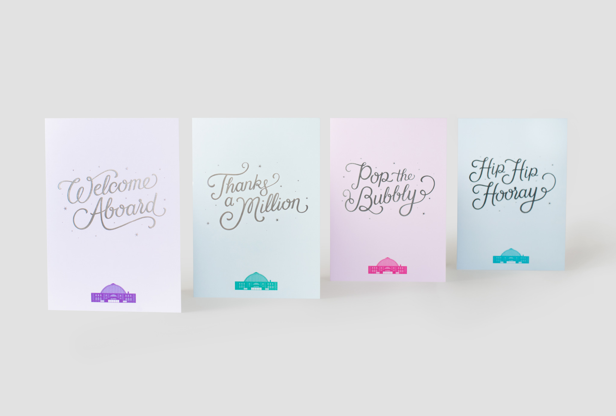 four different coloured cards with greetings and a Olympia London illustration