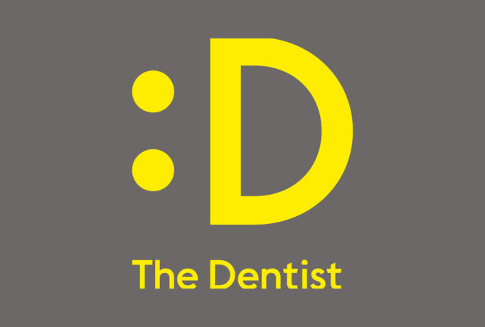 yellow smiley D logo and 'The Dentist' written below on a dark grey background