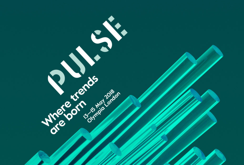 dark turquoise background with crystal-like glowing rods and 'PULSE' 'Where trends are born' written above in white