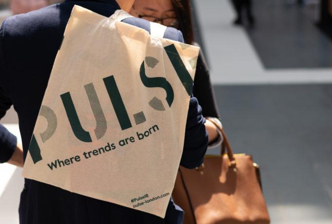 brown PULSE show bag put over by a man's shoulder