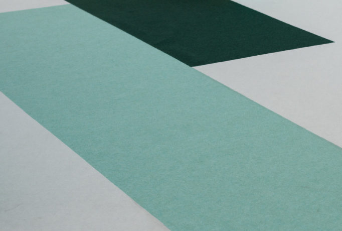 exhibition floor with white, dark and light turquoise carpets
